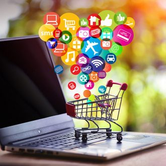 Online Shopping And Online Marketing Concept. Shopping Cart, Lap